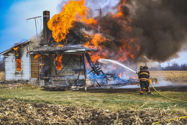 Volunteer Firefighters Practicing During a Live Burn. thumbnail