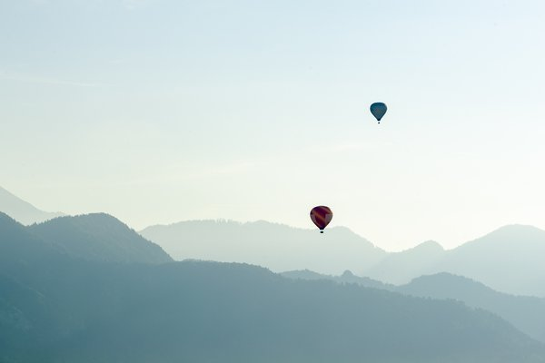 Two Hot Air Balloons Over Lake Bled thumbnail