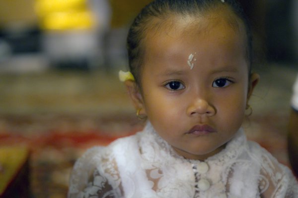 Balinese Girl with Rice thumbnail