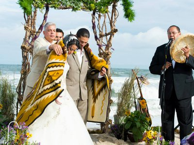 An Indigenous couple marries on the beach at Assateague Island National Seashore and Assateague State Park. Many of the United States' National Parks are places of historical, cultural, and sacred meaning for Native communities. (Photo used with the permission of Desirée Shelley Flores)