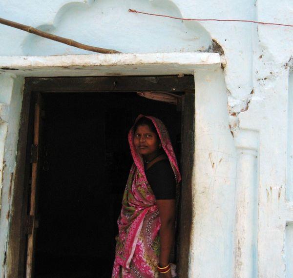 Woman in doorway, Old Khajuraho, India thumbnail