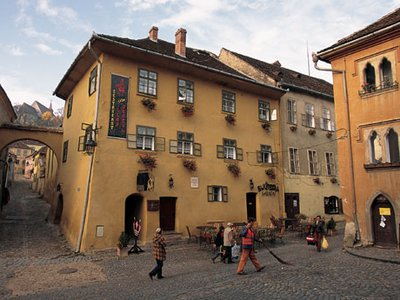 """The house of """"Vlad the Impaler"""" lies in the center of Sighisoara's well-preserved, walled historic district, which dates to the 13th century and has been designated a UNESCO World Heritage Site. Uproar from preservationists, including England's Prince Charles, prompted planners to find another site for the Dracula Park."""
