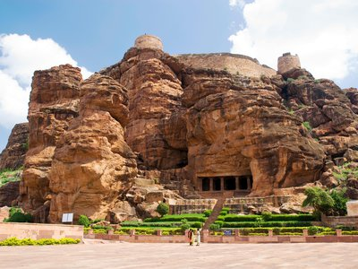 The embellished cave temples of Badami are among the earliest examples of rock-cut caves in southern India. The Chalukyas, who ruled over Deccan between the sixth and eighth centuries, oversaw the transition from rock-cut to freestanding, structural architecture.