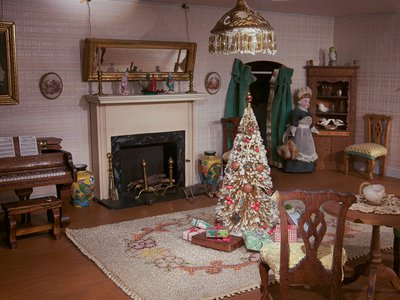 """Bradford saw the dollhouse, shown decorated for Christmas, as ever evolving: """"I shall never be completely satisfied with its creation."""""""