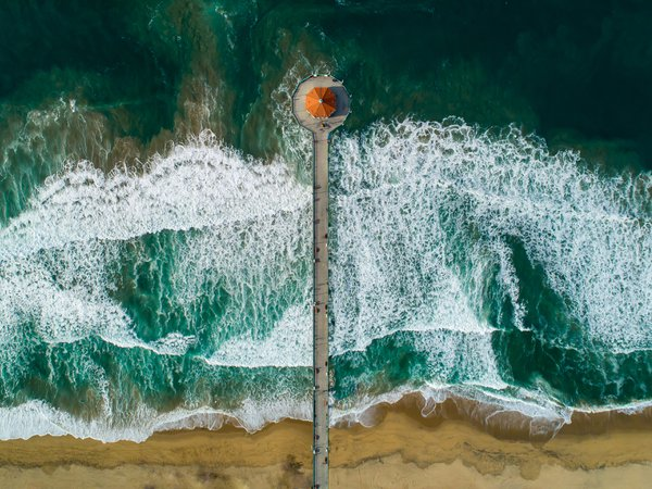 Manhattan Beach California Pier looking straight down on a big wave day. thumbnail