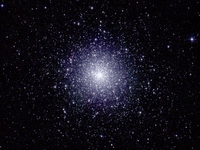 An infrared image of 47 Tucanae, a dense globular cluster of stars located roughly 16,000 light years from Earth. A new study has predicted that a black hole lies at its center.