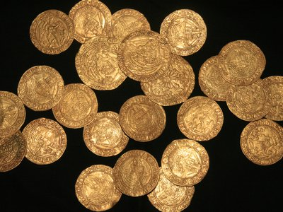 A family in southern England found the trove of 64 coins while gardening.