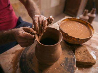 Vahagn working on a clay jug. (Photo by Narek Harutyunyan, My Armenia Program)