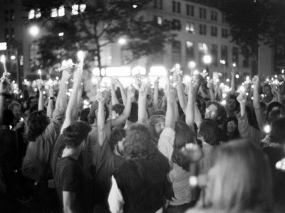 A candlelight vigil is tinged with a sense of resistance and resilience as activists honor the second anniversary of Stonewall, 1971.
