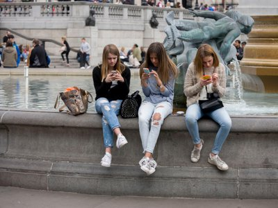 The impulse to check your phone after someone nearby checks theirs is an example of the chameleon effect, new research suggests.