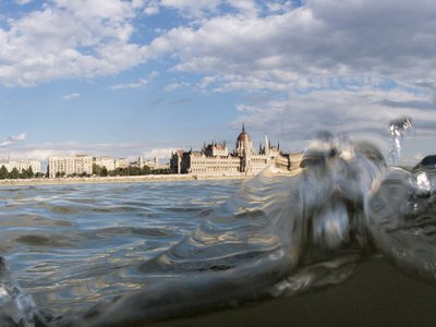 """""""The Danube River Project"""" explores the waterway using underwater equipment to show scenes—like this one of Budapest—partly above and partly below the surface."""