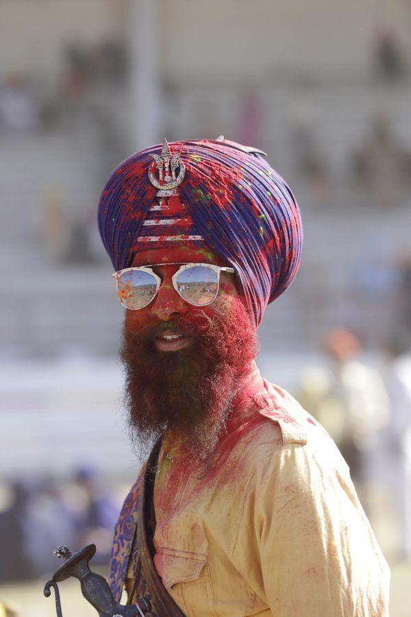 A man enjoying festival of colour. thumbnail