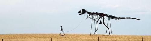 20110520083126caveman-skeleton-walk-dinosaur.jpg