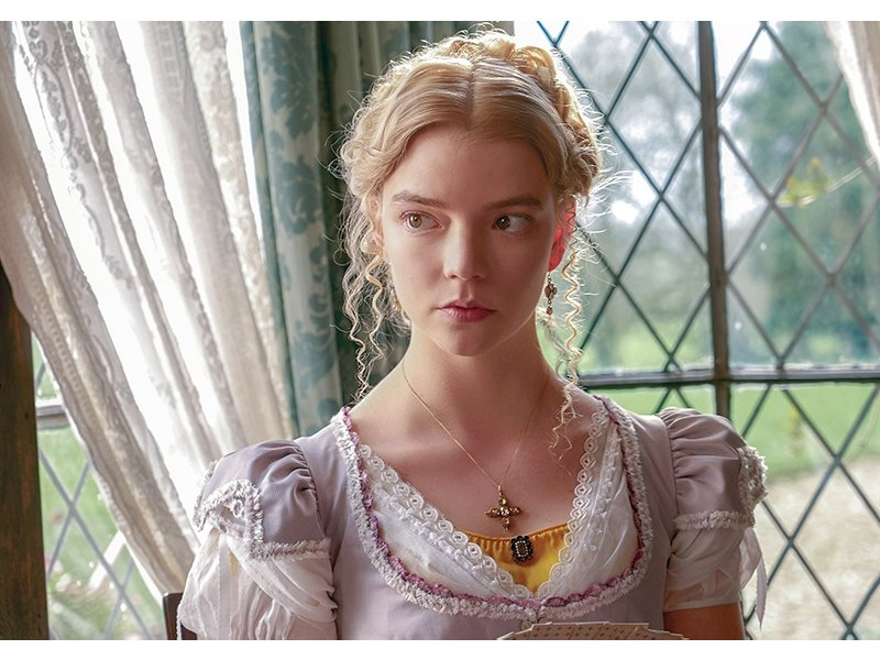 Anya Taylor-Joy playing Emma in front of a windowpane