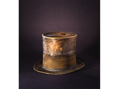 The top hat, with a silk mourning band for his son Willie, was worn last to Ford's Theatre on April 14, 1865.