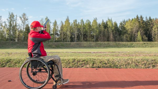 a man in a wheelchair shoots skeet  thumbnail