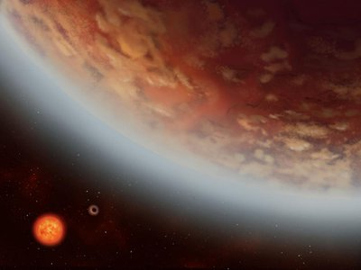 An artist's illustration of the planet K2-18b and another planet, K2-18c, that orbits closer to the parent star. Both planets orbit a red dwarf about 110 light-years from Earth in the constellation Leo.