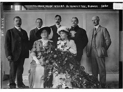 Helen Keller and Anne Sullivan Macy at a New York flower show, circa 1913.