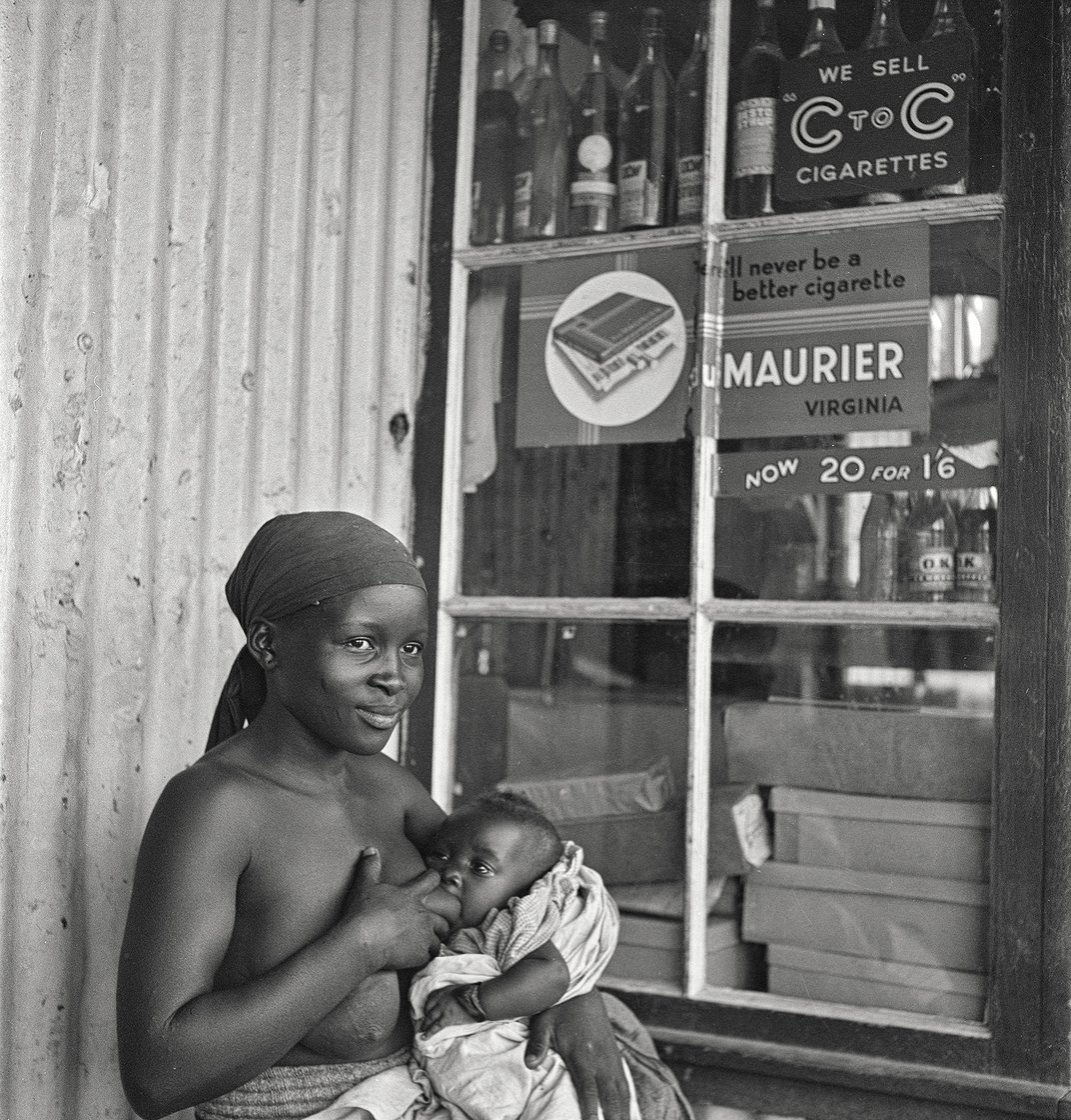 Woman breastfeeding baby, Natal, South Africa