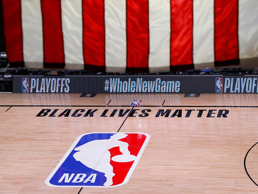 An empty court and bench seen shortly after the intended start of an NBA basketball playoff game between the Milwaukee Bucks and the Orlando Magic on Wednesday, Aug. 26.