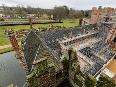 Oxburgh Hall, a moated Tudor manor house in Norfolk, England, is currently undergoing a major renovation project to fix its roof.