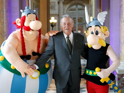 Cartoonist Albert Uderzo poses with Asterix (R) and Obelix (L) prior to a press conference at the Monnaie de Paris on March 25, 2015.