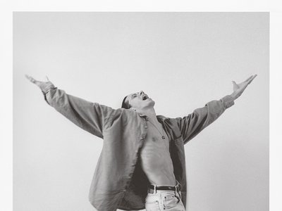 The enthralling c. 1993 portrait of Anthony by ADÁL (detail above), face and palms to the sky, captures the performer's signature flair.