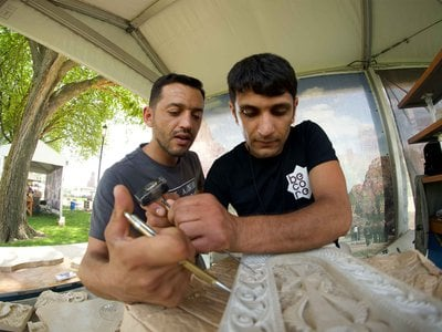 This past October, Ruben Ghazarayan (above left with his brother Karen at the 2018 Smithsonian Folklife Festival) fought on the frontlines of the Nagorno-Karabakh conflict, his brother is selling their Armenian cross-stones to support their families during the conflict.