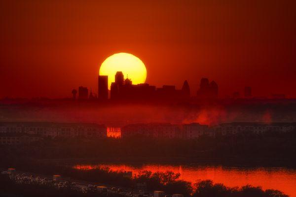 Sun sets behind the Dallas Skyline thumbnail