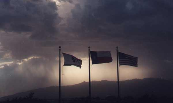 Elpaso tx storm as viewed from hotel balcony with flags blowing thumbnail