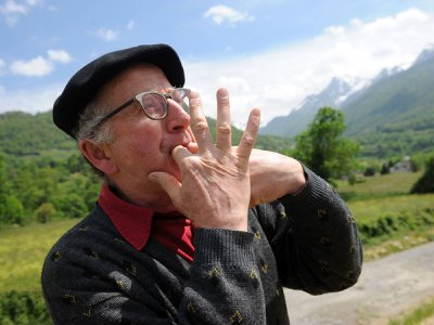 A man in Laruns, southwestern France, whistling as a form of speech. Like others in the Canary Islands and elsewhere, local people have learned to whistle their language to communicate across long distances. Linguists are studying whistled speech to help understand which sound elements are essential to comprehension.