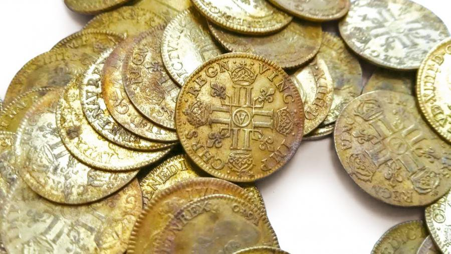 A close up shot of a pile of gold coins