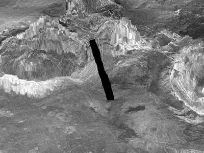 A 3D model of Venus' surface featuring two coronae, which are ring-shaped geological structures associated with volcanic activity. Venus' volcanoes were once thought to be dormant but new research found that at least 37 coronae, including one named Aramaiti which is on the left in this image, are active volcanoes.