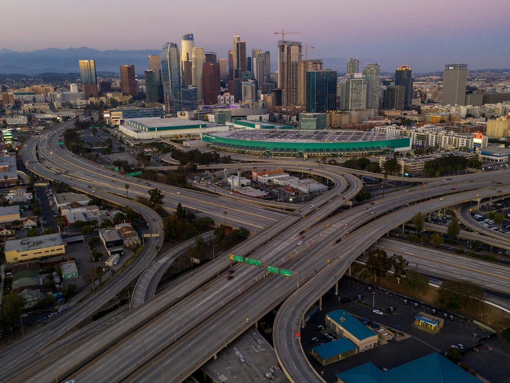 An aerial view of extremely light traffic on Los Angeles' 10 and 110 freeway interchange.