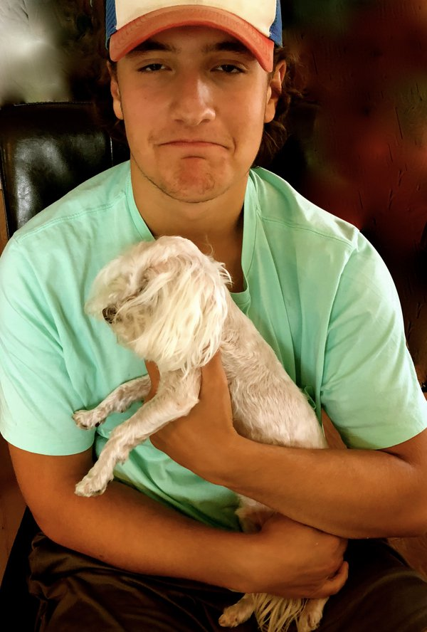 Young man with very small dog named CoCo. thumbnail