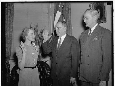 Margaret Chase Smith sworn in on June 10, 1940 to fill the vacancy left by her husband, Rep. Clyde Smith. Left to right in the picture: Margaret Chase Smith, Speaker William Bankhead and Rep. James C. Oliver, Republican of Maine, who sponsored Mrs. Smith