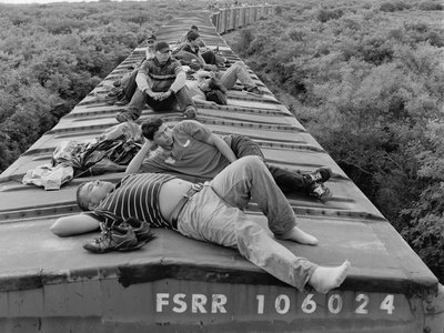 Central American migrants ride a northbound cargo train through the southern Mexican state of Oaxaca. July 2010.