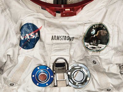 Armstrong's pressurized spacesuit, measuring nearly 5 feet 7 inches tall, featured anodized aluminum gauges and valves. (Detail)