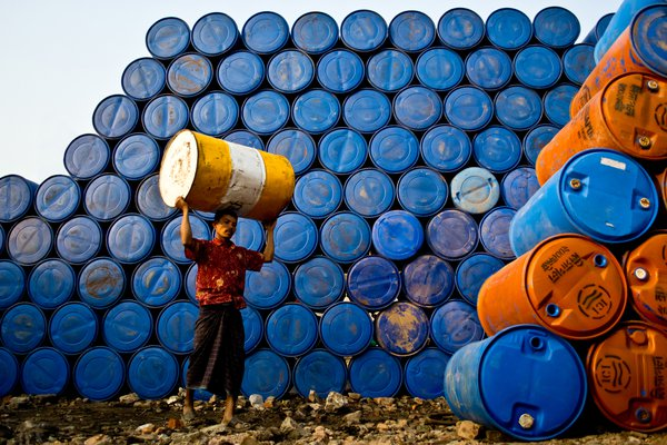 This day laborer works at a chemical drum recycling plant. All he has to do is to carry 15 kg drums and pile them up at the plant. It is a very risky job and a tiresome one with a very small pay. thumbnail
