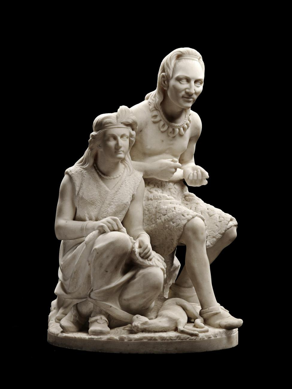 A white marble sculpture of a Native American man and woman sitting