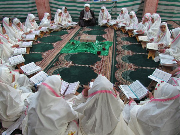 School girls are dressed up for a religious celebration. thumbnail