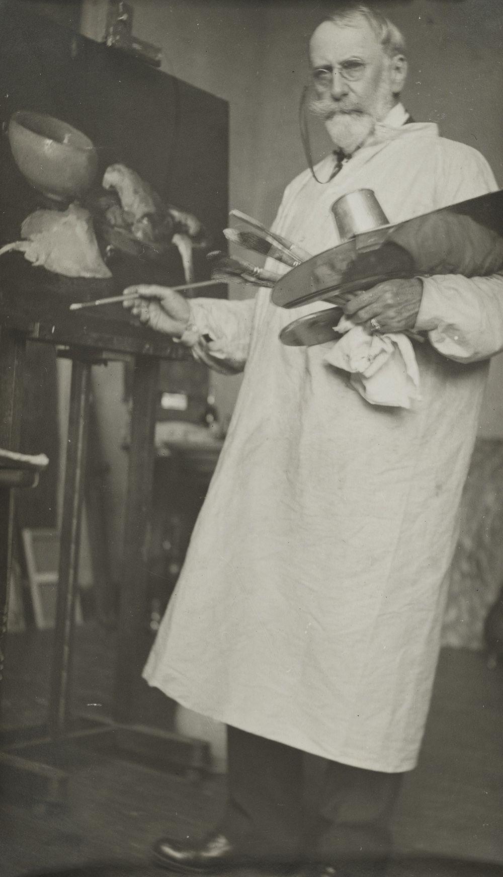 Photograph of William Merritt Chase painting in his studio.