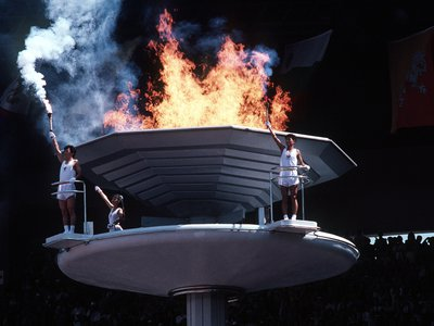 South Koreans stand by the cauldron of the 1988 Summer Olympics