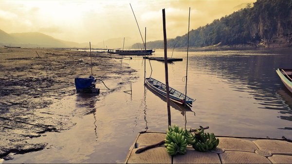 Lonely dock on Mekong River thumbnail