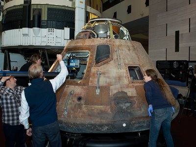 The Apollo 11 Command Module Columbia undergoes a scanning process for the creation of a 3-D model.