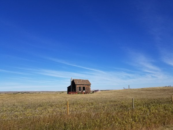 Old homestead with car beside it. thumbnail