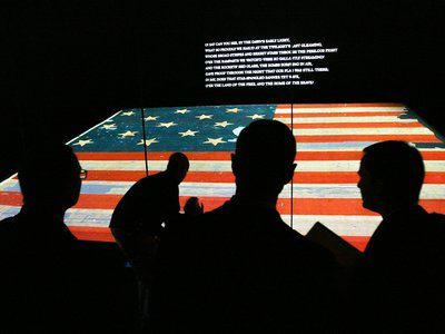 Invitees to the museum's grand reopening in 2008 admire the newly restored flag.