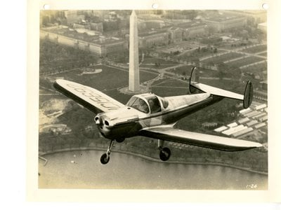 An Ercoupe flies over the nation's capital.