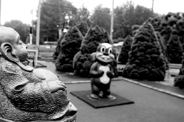 Buddha and Squirrel figures on mini golf course thumbnail