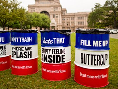"""New """"Don't mess with Texas"""" trash cans at the Texas capitol building in Austin."""